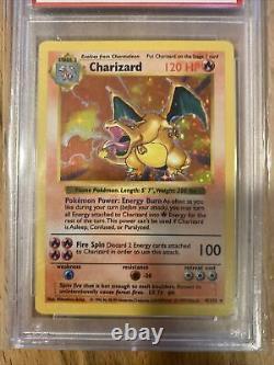 1999 Base Set Holo Charizard 4/102 SHADOWLESS Pokemon Card PSA 8 Mint