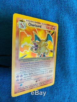 Charizard 4/102 Base Set Pokemon 1999 Unlimited Rare Holographic Card Holo