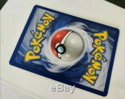 1999 Carte Pokemon 1ère Édition Shadowless De Base Charizard Impeccable (rare)